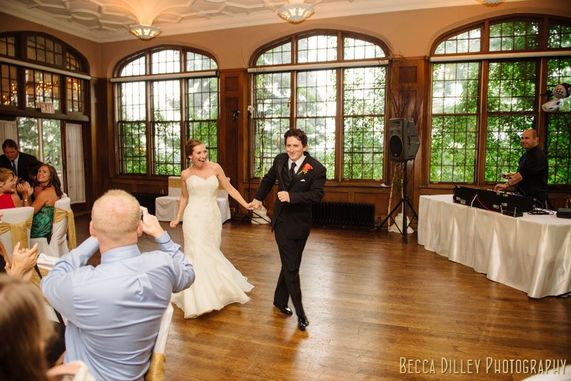 bride and groom enter st paul university club