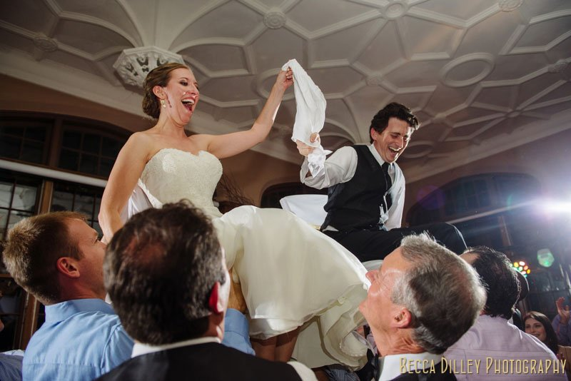 bride and groom lifted on chairs at st paul university club