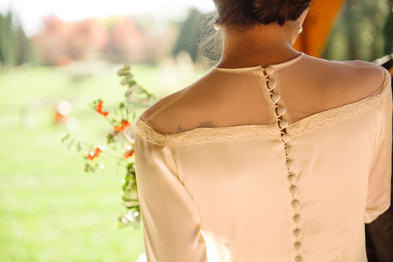 bride wears grandomthers dress with back full of buttons