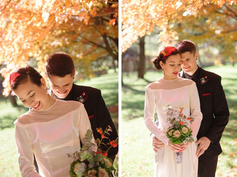 bride and groom under orange leaves