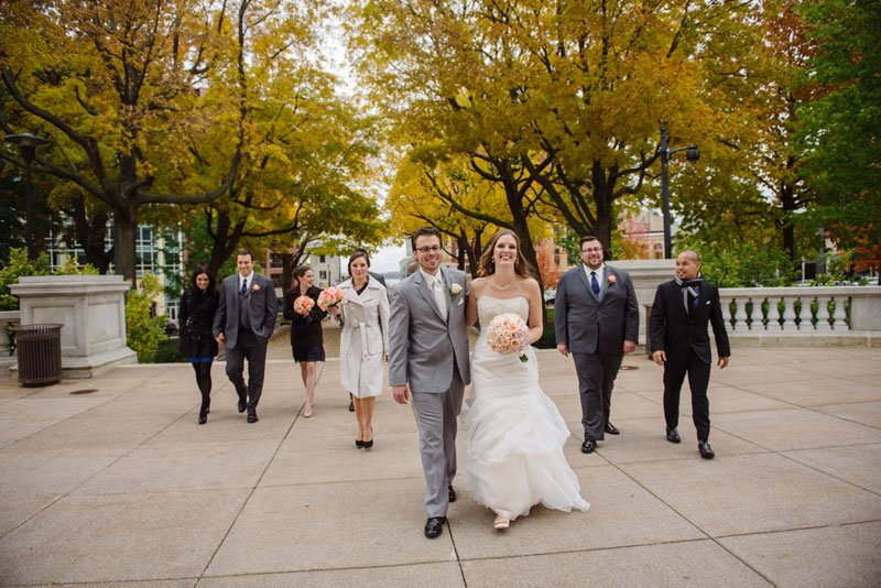 wedding party walks to madison capitol