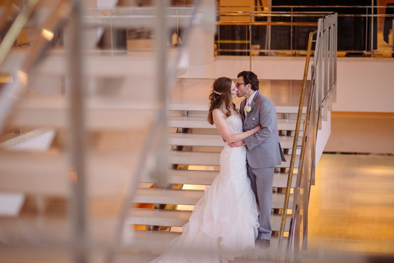 bride and groom between steps at overture center madison