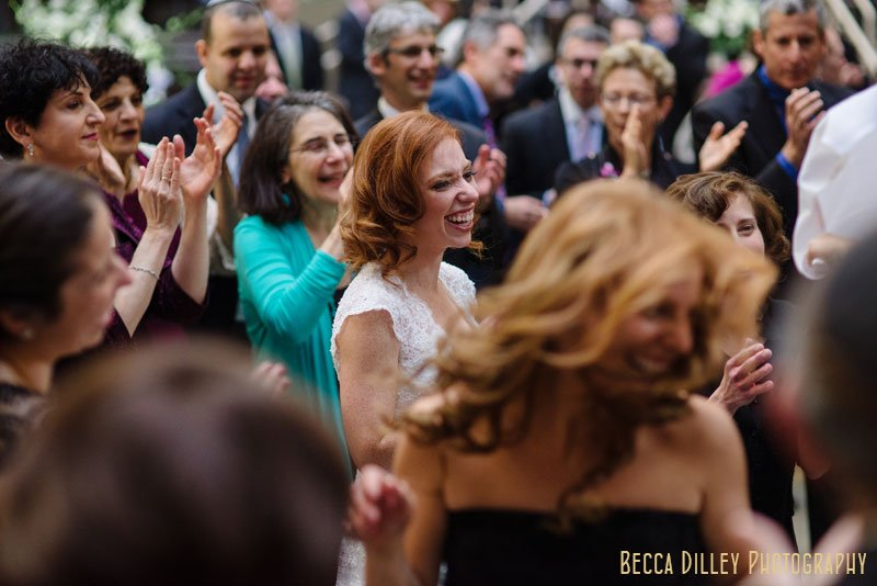 bride dances during hora at IMS Design Center wedding reception