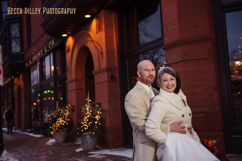 bride and groom in front of WA frost wedding st paul mn winter