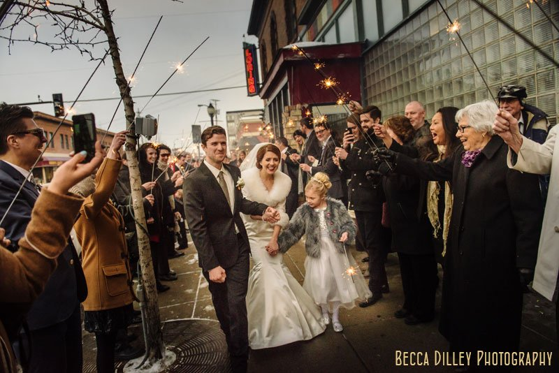 bride and groom with sparkler exit at wedding at loring pasta bar dinkytown