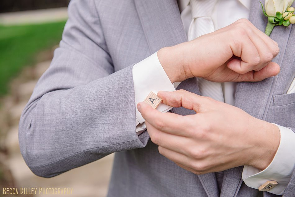 groom with scrabble cuff link at St Maria Goretti church wedding madison wi