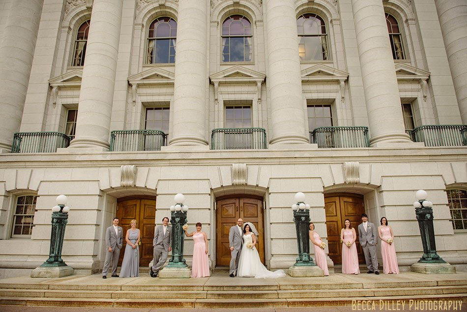 wedding party in pink and grey in front of Wisconsin capitol