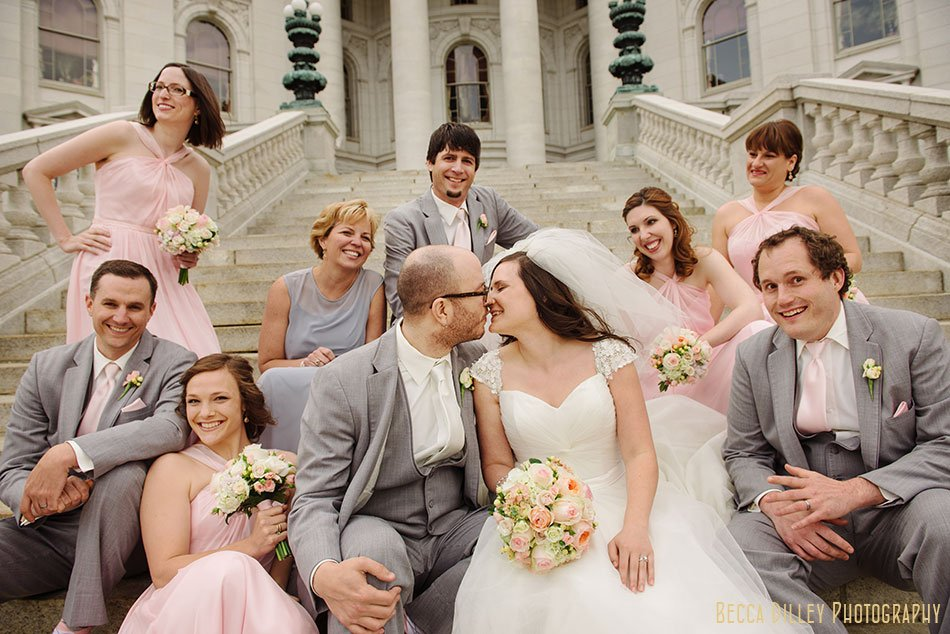 fun photo of wedding party in pink and grey in front of Wisconsin capitol