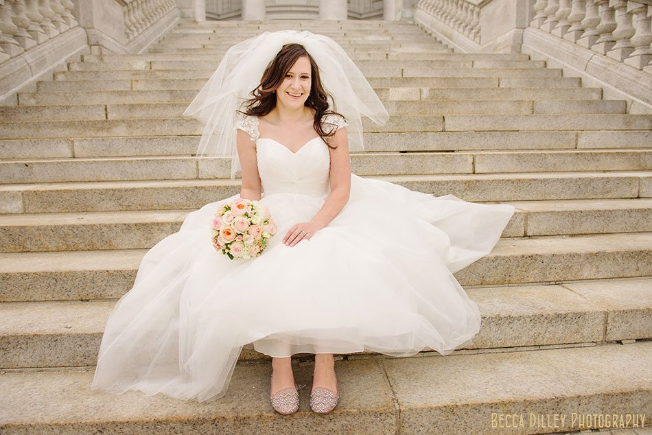 bride with pink shoes sitting on steps of Madison capitol