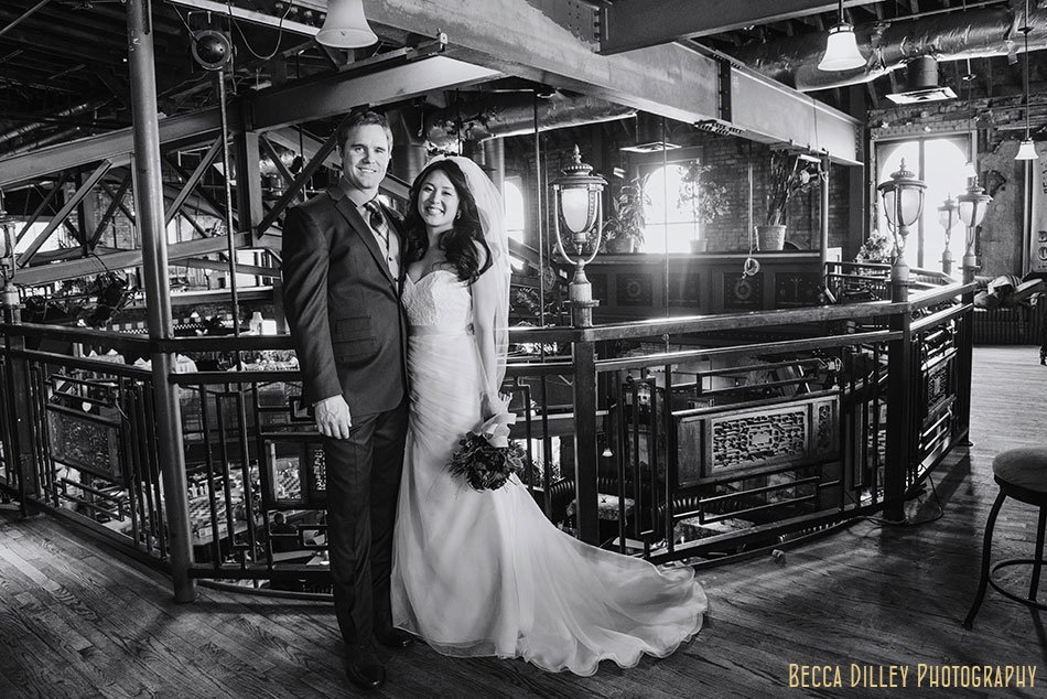 bride and groom with architecture of Loring Pasta Bar Minneapolis wedding
