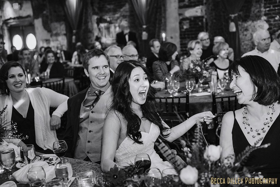 bride laughs during first toast Varsity Theater wedding Minneapolis