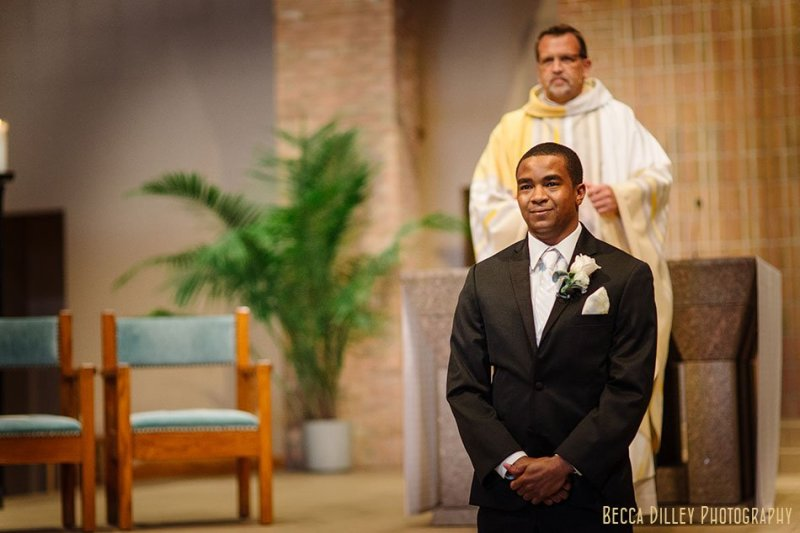 groom waits for bride at altar