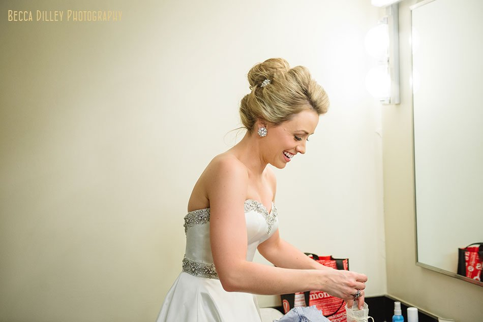 bride getting ready for basillica wedding minneapolis