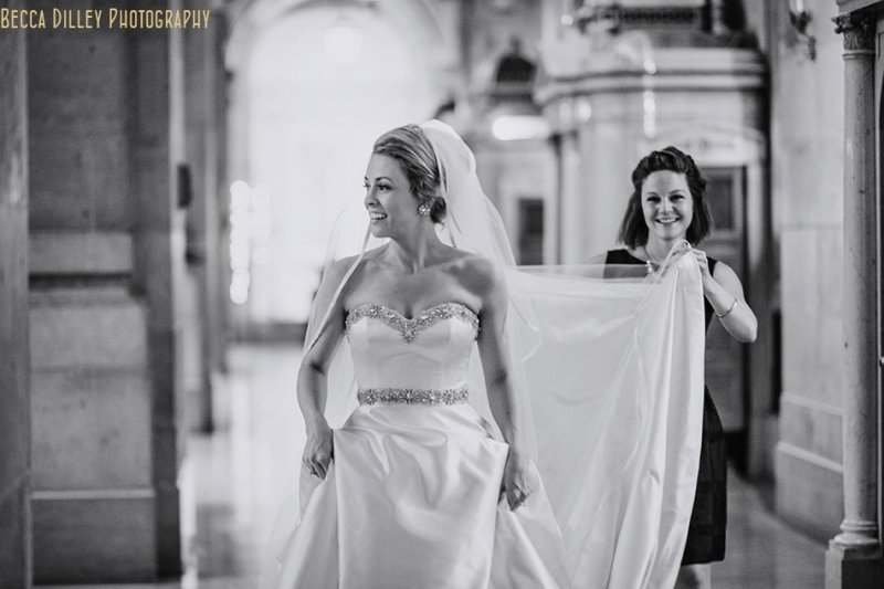 bride walking to meet groom for basillica wedding minneapolis