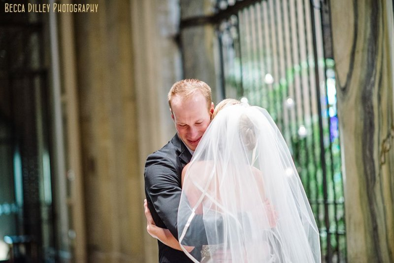 groom sees bride for first time at basillica wedding minneapolis