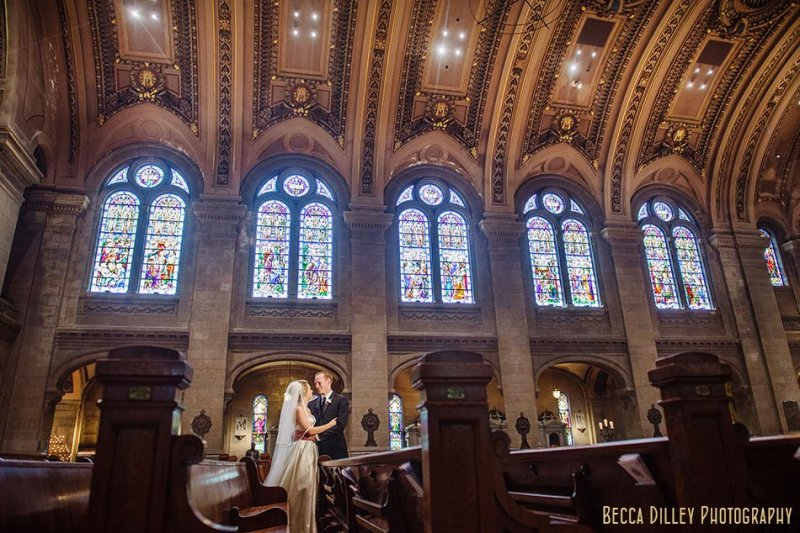 bride and groom under dome inside basillica wedding minneapolis