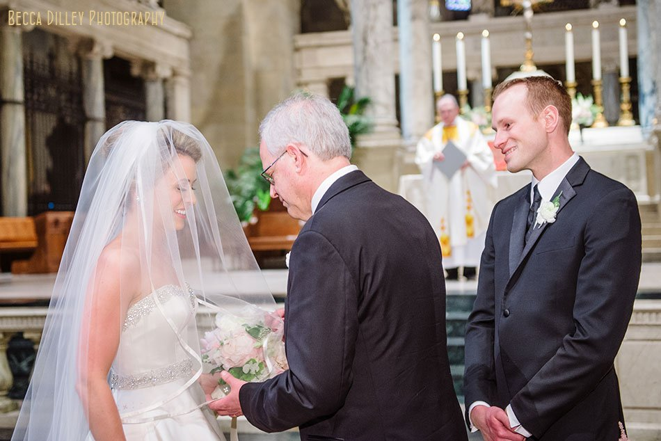 father gives away bride at basillica wedding minneapolis