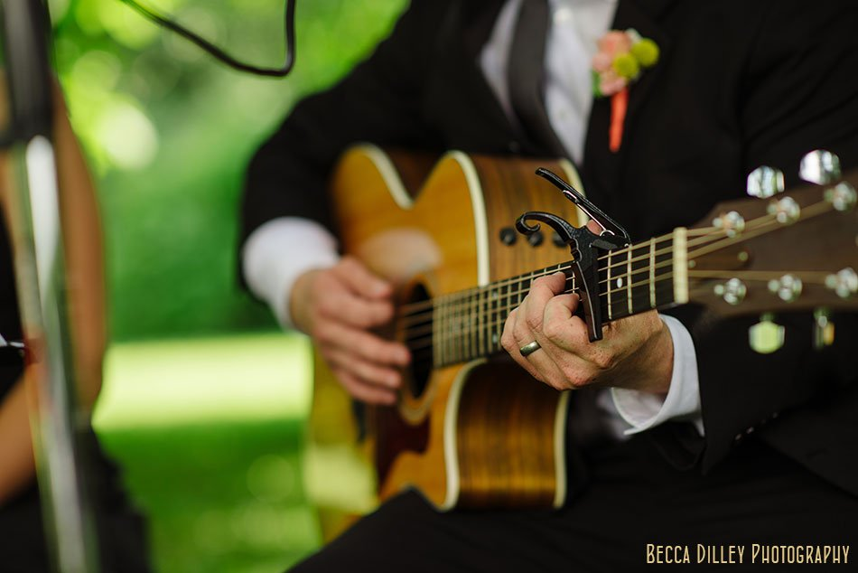 spring green wedding ceremony starts with guitar playing