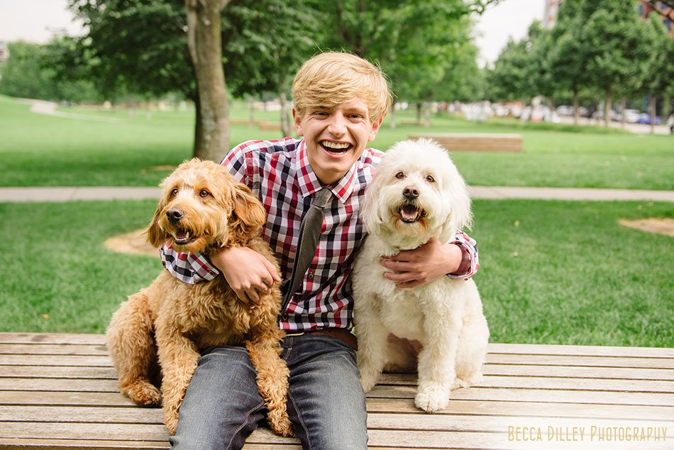 boy with two dogs High School Senior Photographer Minneapolis and St Paul