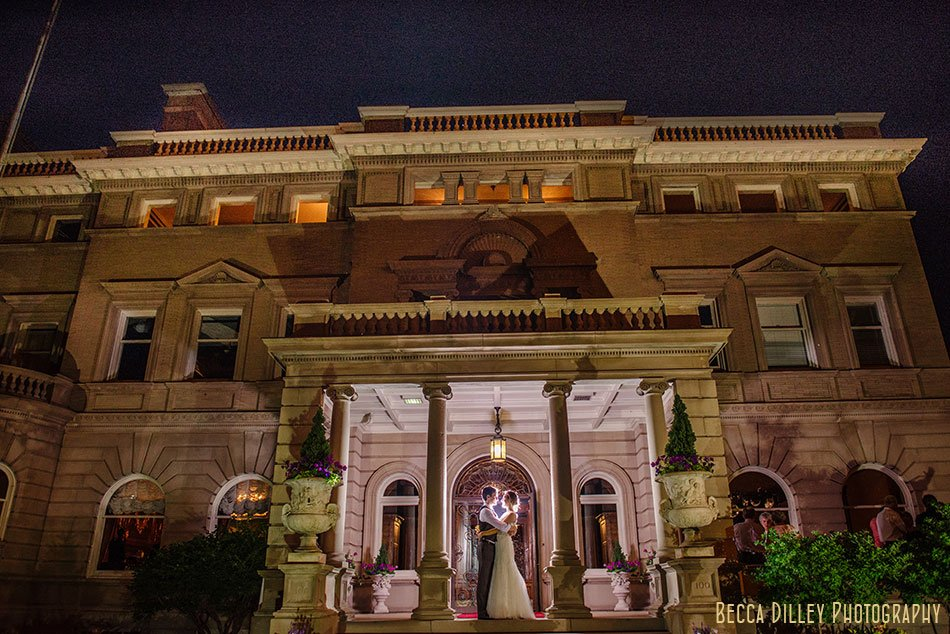 bride and groom outside Semple mansion at night with dramatic lighting