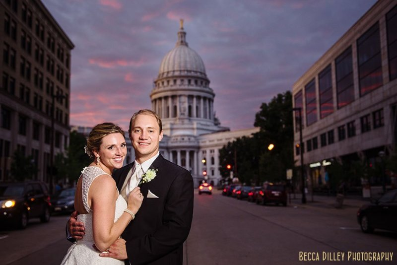 bride and groom with wi capitol at night madison wi