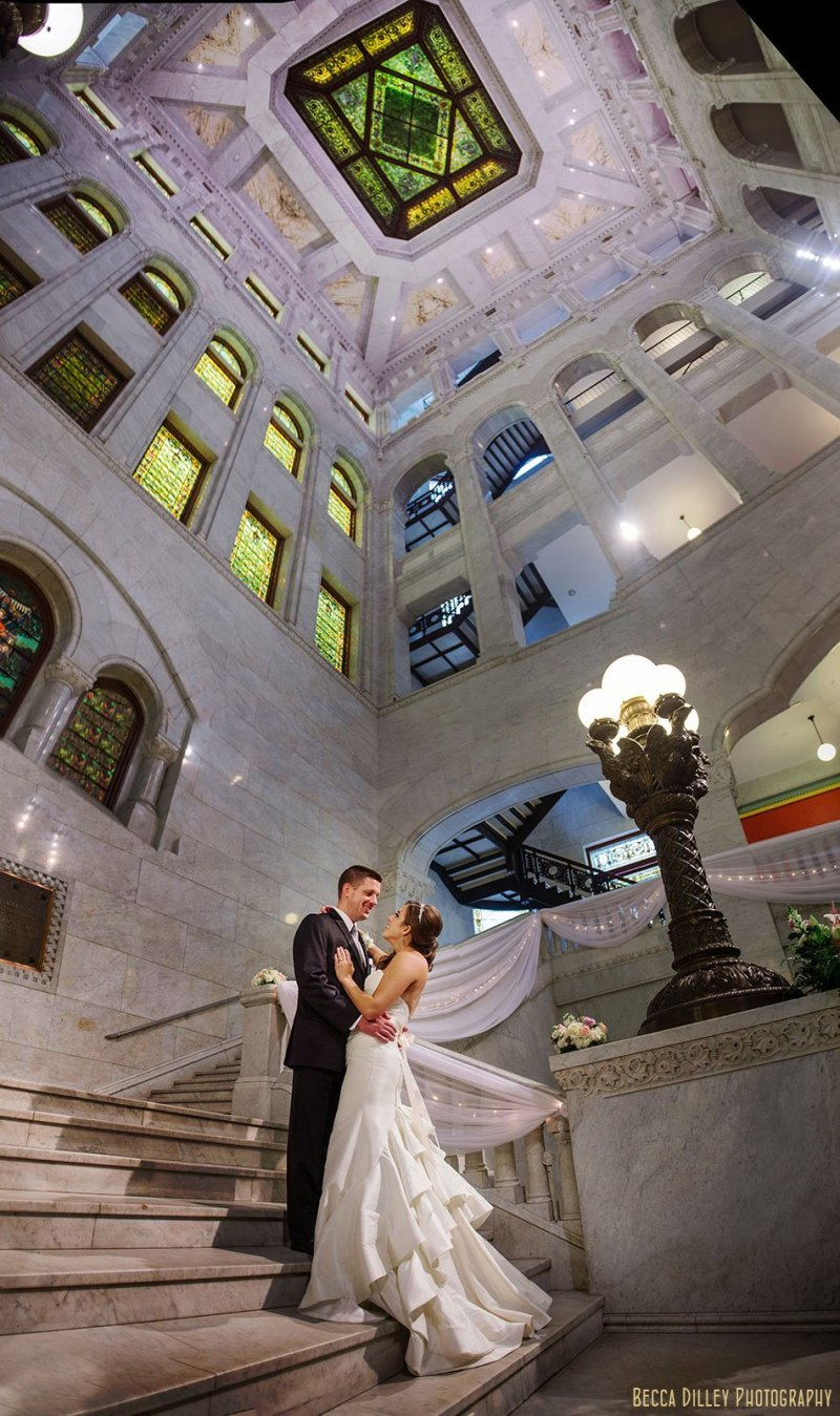 bride and groom on stairs for minneapolis city hall wedding