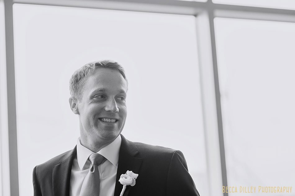 groom in black and white getting ready with his friends