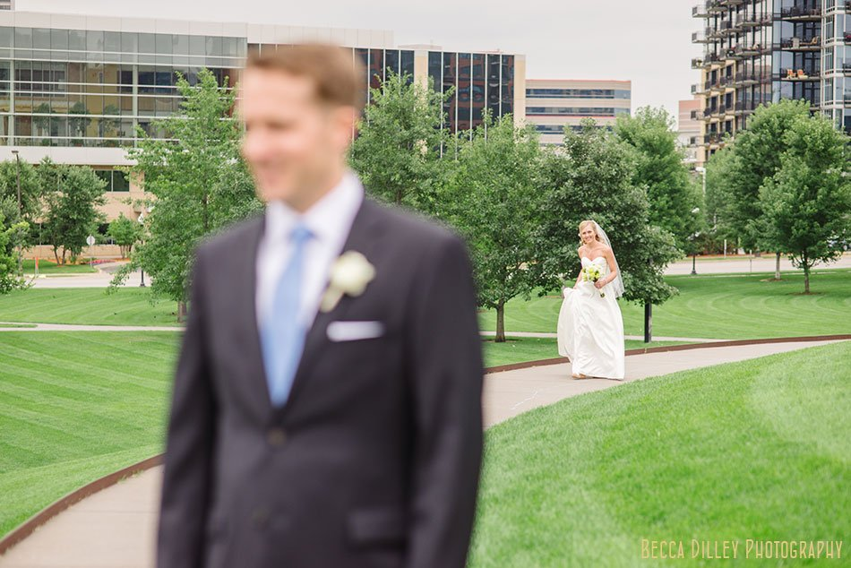 bride walks up gold medal park hill to see groom for the first time before their silverwood park wedding