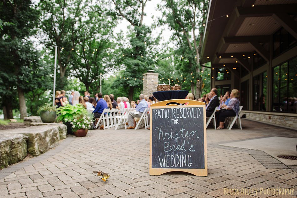 chalk board announcing the ceremony at silverwood park wedding minneapolis