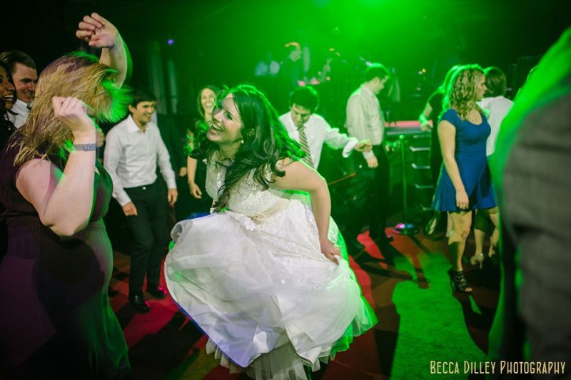 bride dancing and laughing varsity theater wedding reception