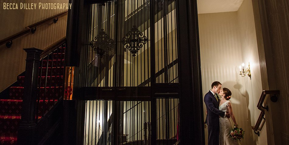 bride and groom by elevator of minneapolis club wedding