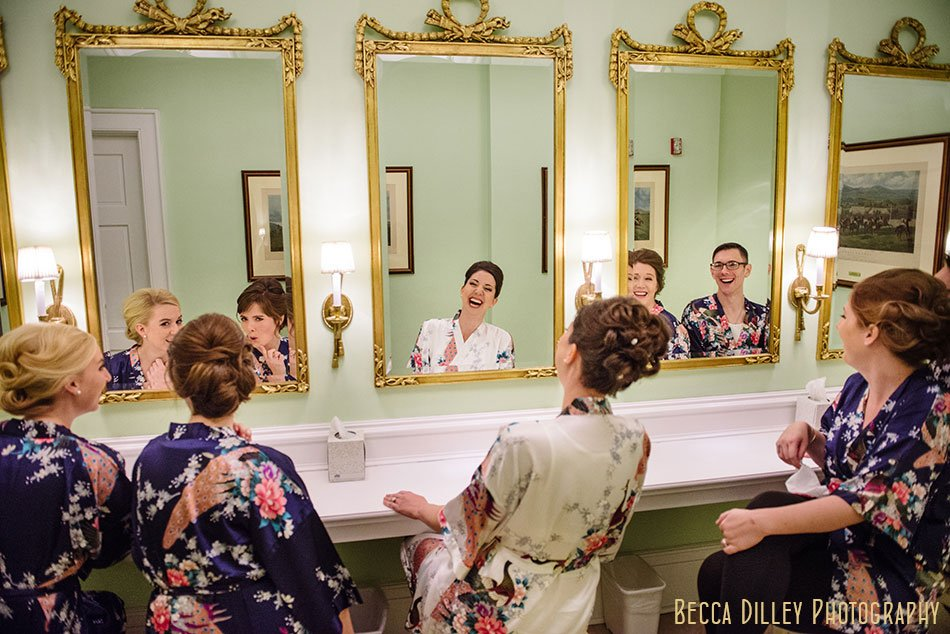 bride and bridesmaids in front of mirrors Minneapolis club wedding