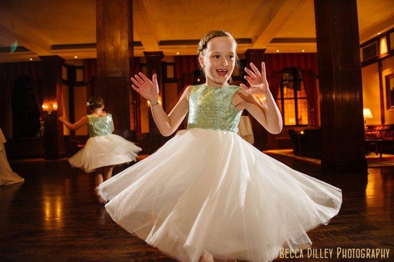 flowergirl dancing in sequin top Minneapolis club wedding