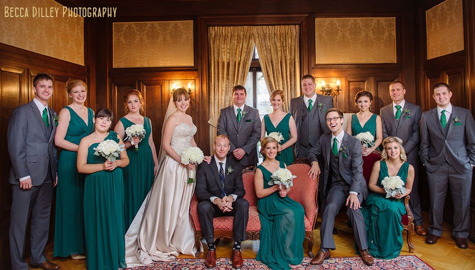 bride and groom with large wedding party in green minneapolis wedding at gale mansion