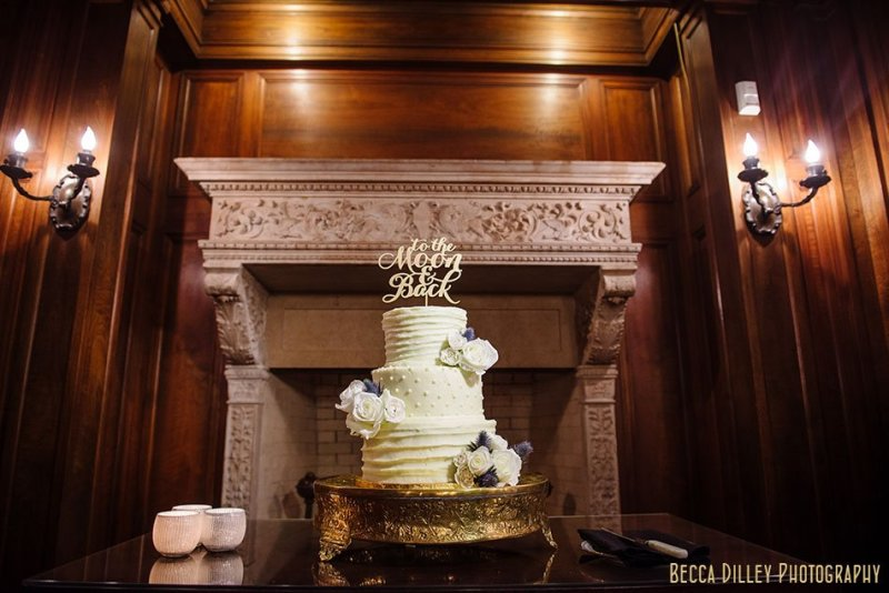 cake with topper to the moon and back minneapolis wedding at gale mansion