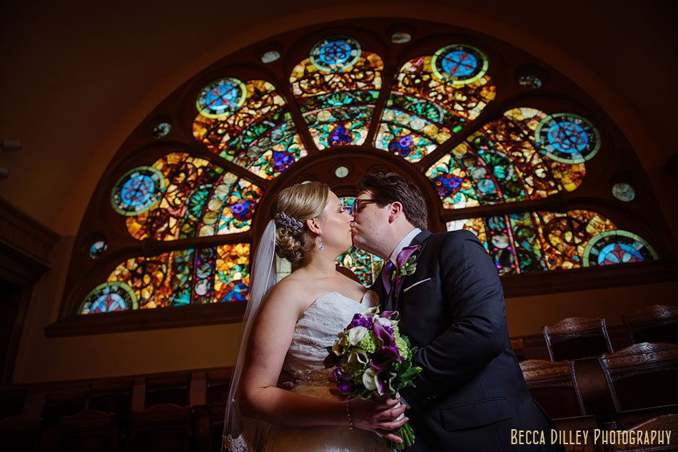 Central Presbyterian st paul wedding couple with dramatic stained glass