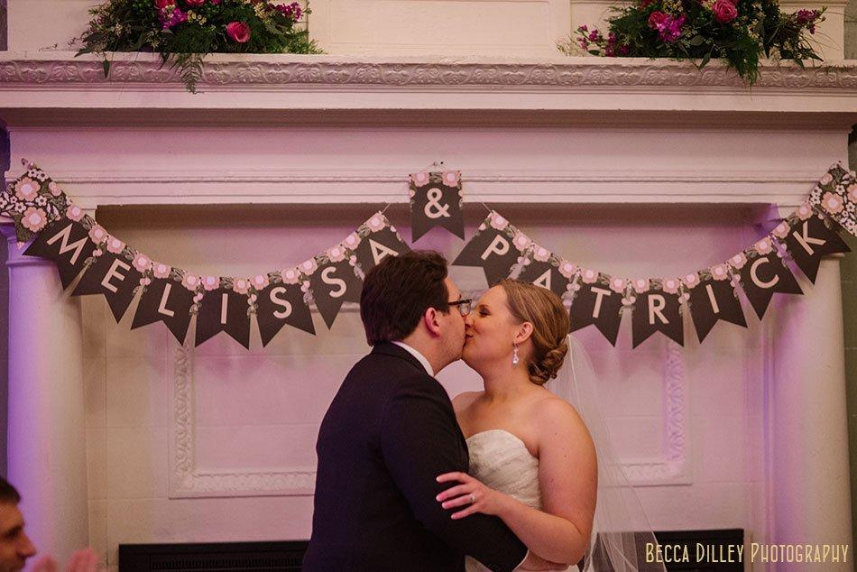 bride and groom kiss st paul university club wedding