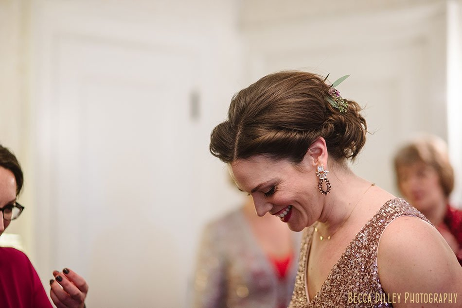 bride laughing st paul college club winter wedding mn