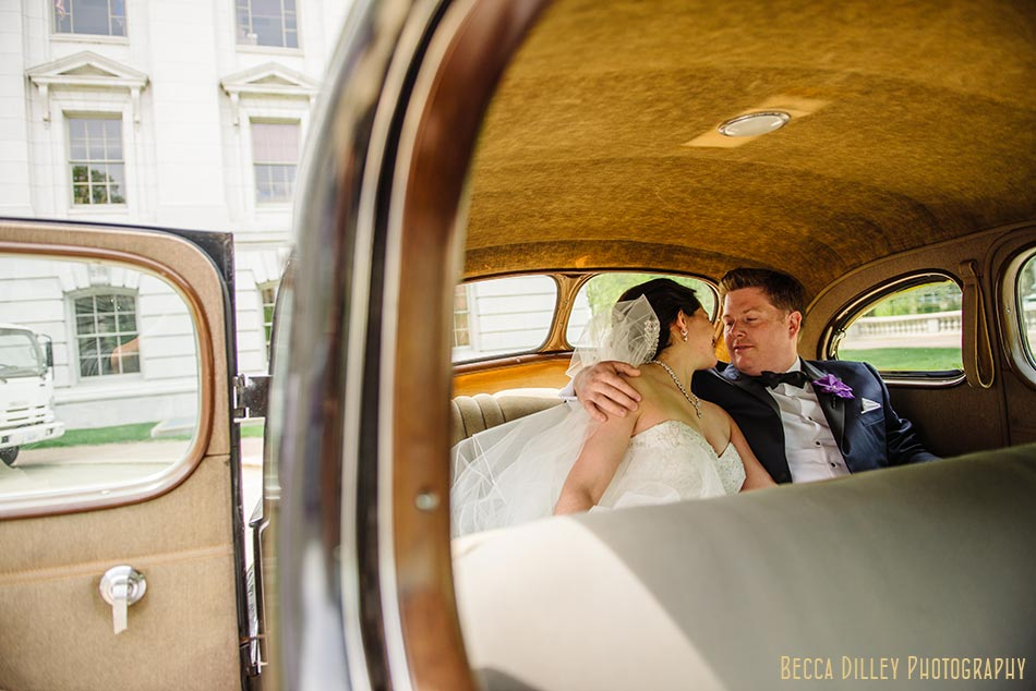bride and groom in vintage cab madison wisconsin wedding