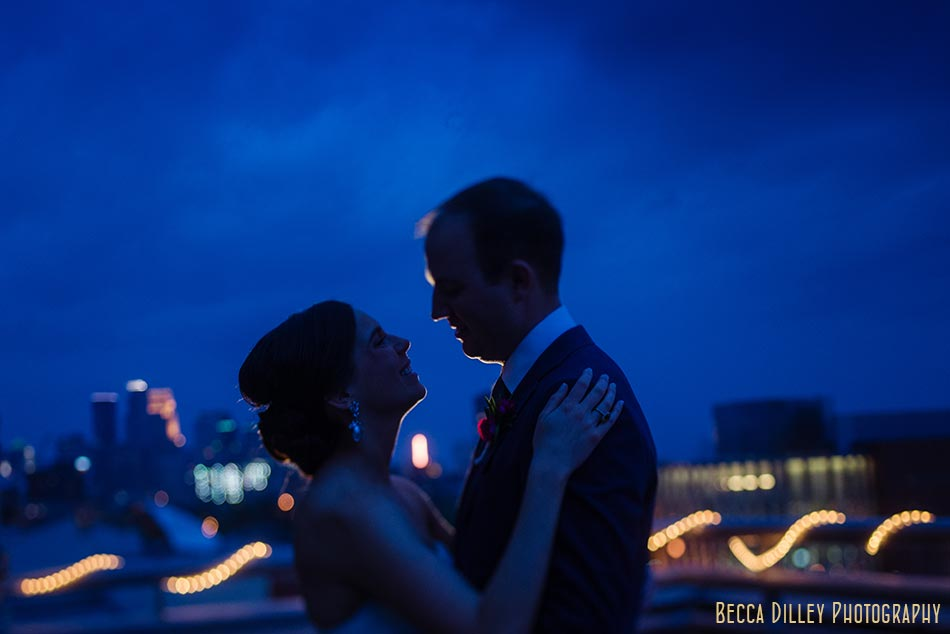 dramatic blue portrait of couple at night campus club of mn wedding