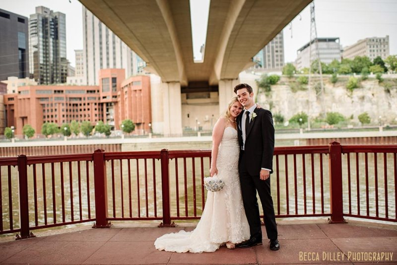 comfortable wedding photography in st paul - couple under bridge