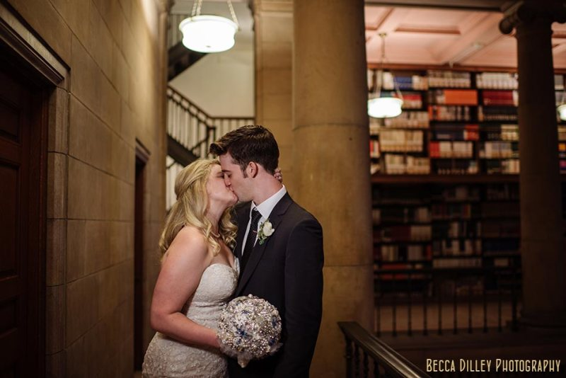 couple in library stacks for comfortable wedding photography st paul