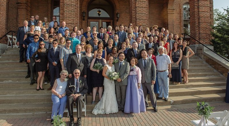 all wedding guests on stairs Stillwater Historic Courthouse Wedding mn
