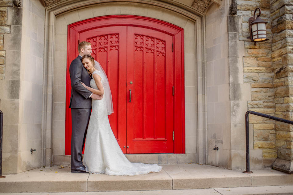 bride and groom by red door St Lukes Episcopal church wedding minneapolis