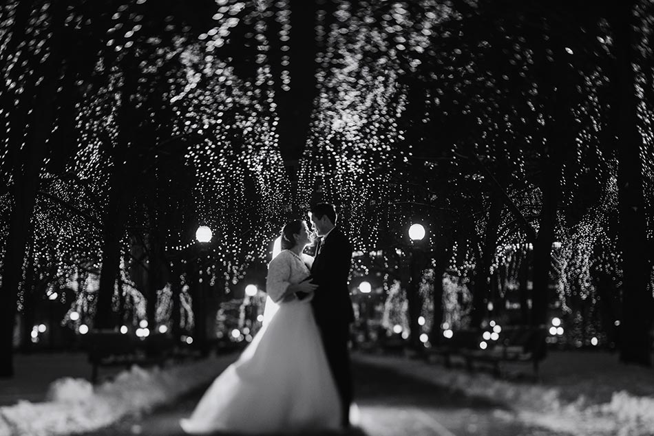 couple with rice park lights St Paul Hotel winter wedding mn