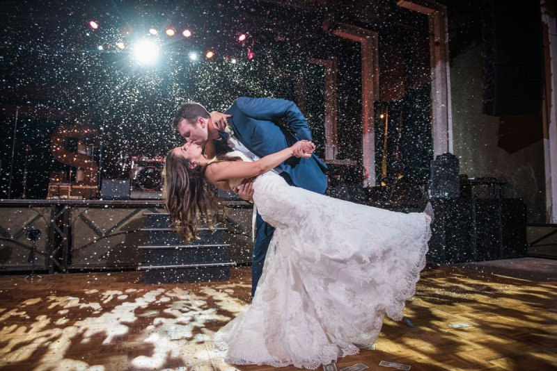 indoor snow for first dance fun minneapolis wedding at greek orthodox church and varsity theaterfun minneapolis wedding at varsity theater