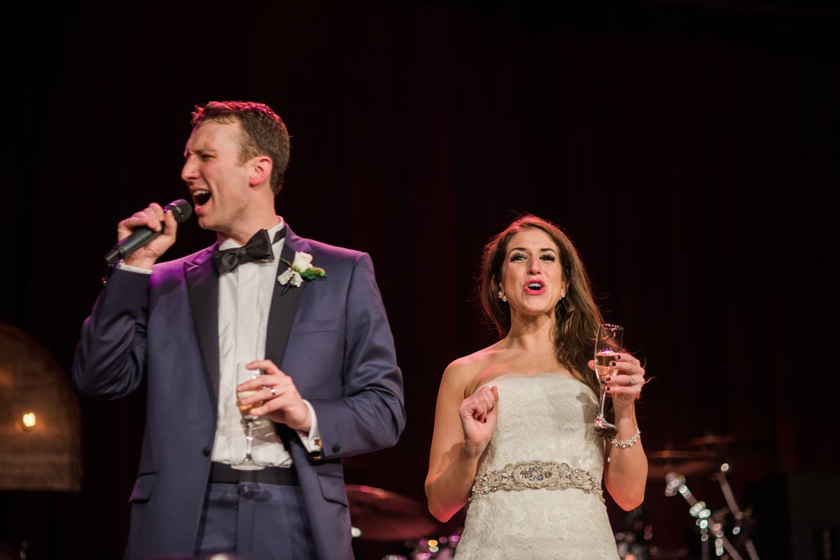 bride and groom welcome guests fun minneapolis wedding at greek orthodox church and varsity theaterfun minneapolis wedding at varsity theater