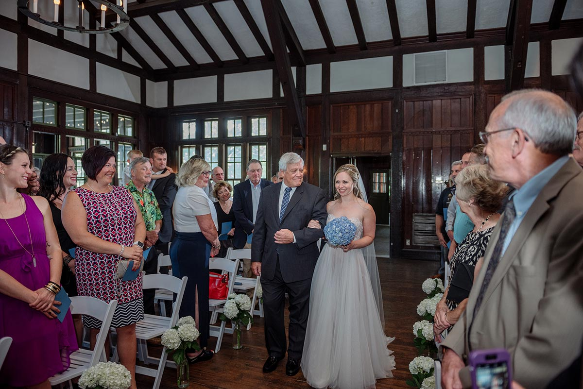 bride and father walk down Outdoor Minneapolis Wedding