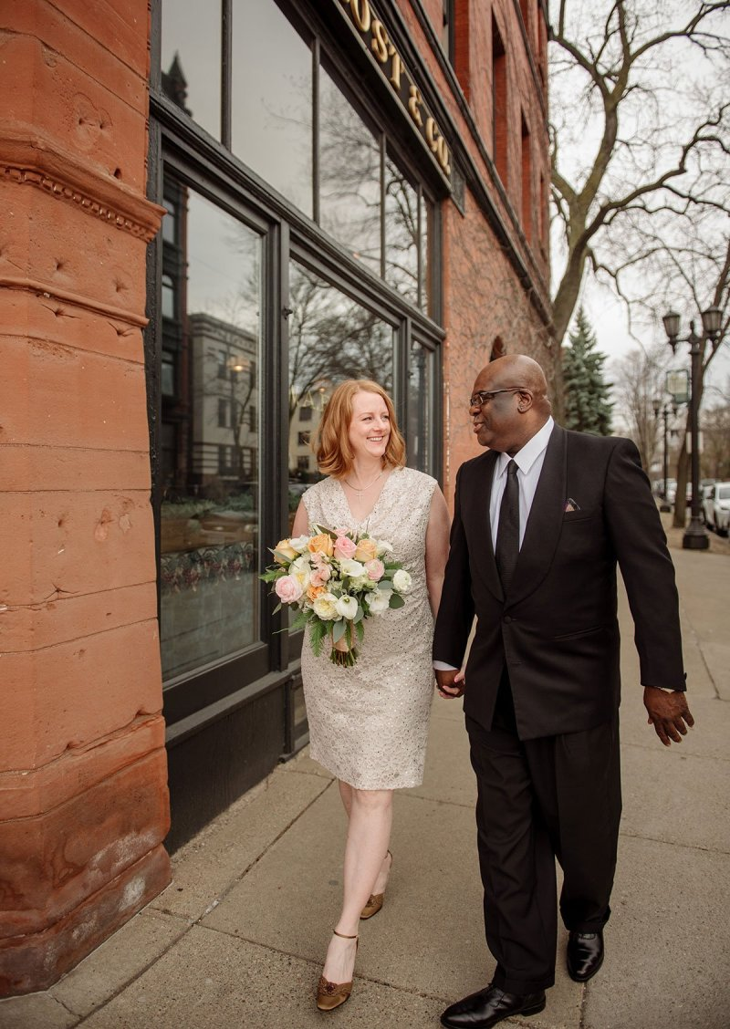 bride and groom arrive Intimate wa frost wedding st paul mn