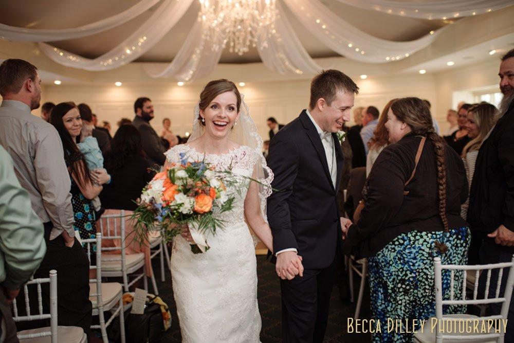 couple walk down aisle St Paul College Club Wedding MN